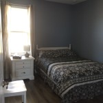 double bed, dresser and night stand